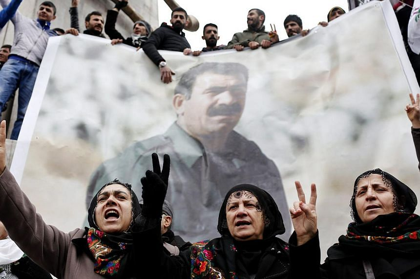 Supporters of the Kurdistan Workers' Party (PKK) imprisoned PKK leader Abdullah Ocalan who has been held in detention by Turkey for 16 years. The jailed leader has urged PKK to lay down their arms. -- PHOTO: EPA