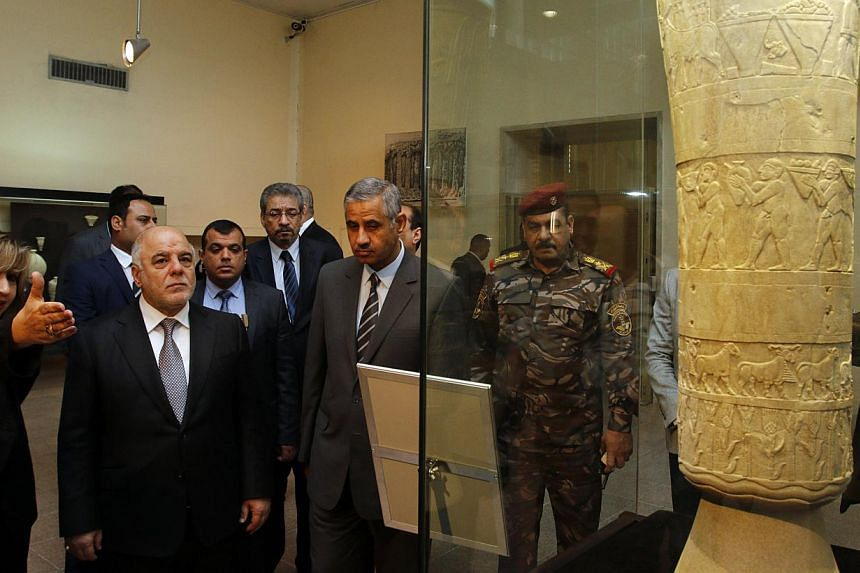 Iraqi Prime Minister Haider al-Abadi (second from left) visits the Iraqi National Museum in Baghdad onFeb 28, 2015. Iraq's national museum officially reopened onSaturday after 12 years of painstaking efforts during which close to a third