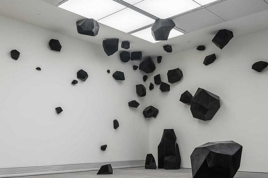 Artist Ding Yi's solo show in Singapore includes his Appearance Of Crosses series as well as his latest art installation, Flying Stone (above). -- PHOTO: SHANGHART GALLERY