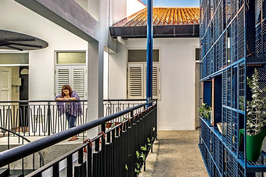 Bedrooms (above) in the mini apartments of the Crane Road and a communal kitchen (below). Linkways (left) between the apartments double as communal areas where neighbours meet.