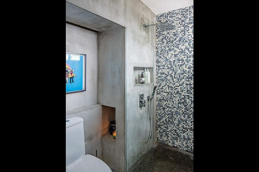 "Concrete stamping has been used to create textures on the walls of this three-room HDB flat. Its non-structural walls have been removed to let in more light (left) as well as to allow interior designer Jonathan Poh to create a ""hotel suite"" look (bel"