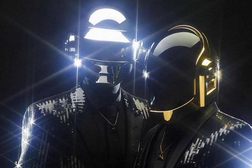 Daft Punk duo Guy-Manuel de Homem-Christo and Thomas Bangalter as they usually appear - in helmets. -- PHOTO: DAFT PUNK