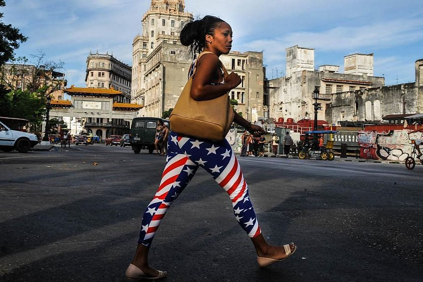 """A woman wearing leggings with the US flag design, walks in Havana on Jan 23, 2015.The United States said Friday it could reopen its embassy in Havana before a high-profile summit of the Americas in April, but cautioned """"serious disagreements"""" r"""