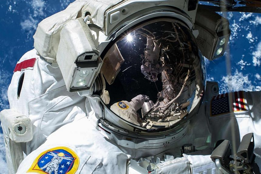 """Nasa astronaut Barry """"Butch"""" Wilmore at the International Space Station in a Nasa handout photo taken Feb 21, 2015,Two US astronauts will go ahead with a spacewalk this weekend despite a flaw in one of the spacesuits that allowed water to seep"""