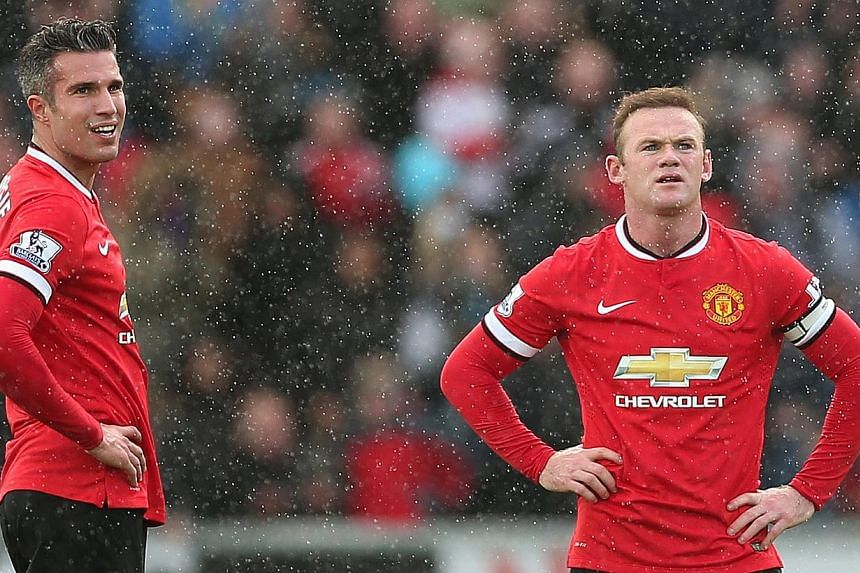 Manchester United manager Louis van Gaal says his expensively assembled squad have not challenged for the Premier League title this season because they do not have a prolific striker like their rivals. -- PHOTO: REUTERS