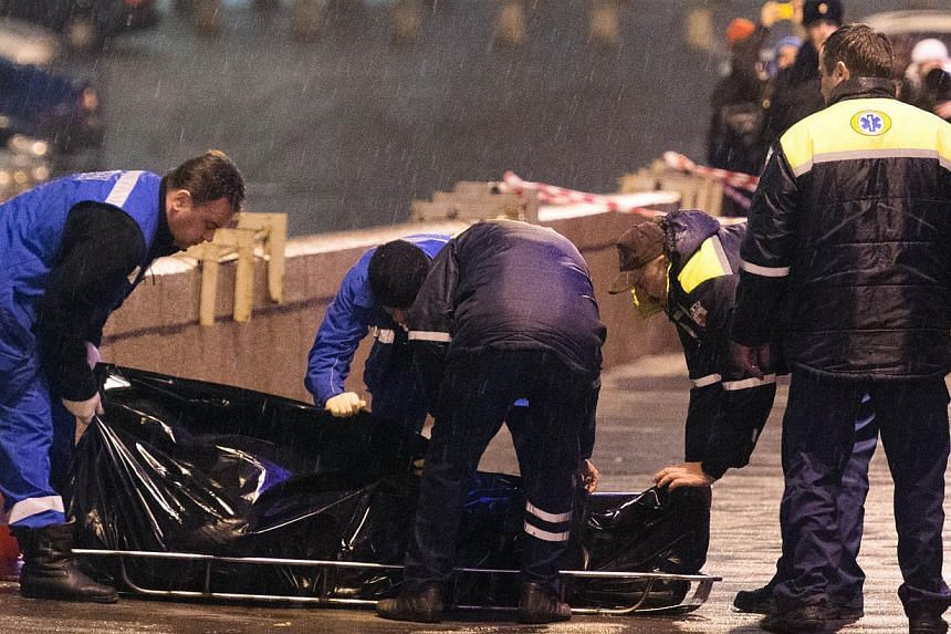 Russian opposition leader Boris Nemtsov, a fierce critic of President Boris Yeltsin, was shot dead in central Moscow on Moskvoretsky bridge near St. Basil cathedral on Feb 28, 2015. -- PHOTO: AFP