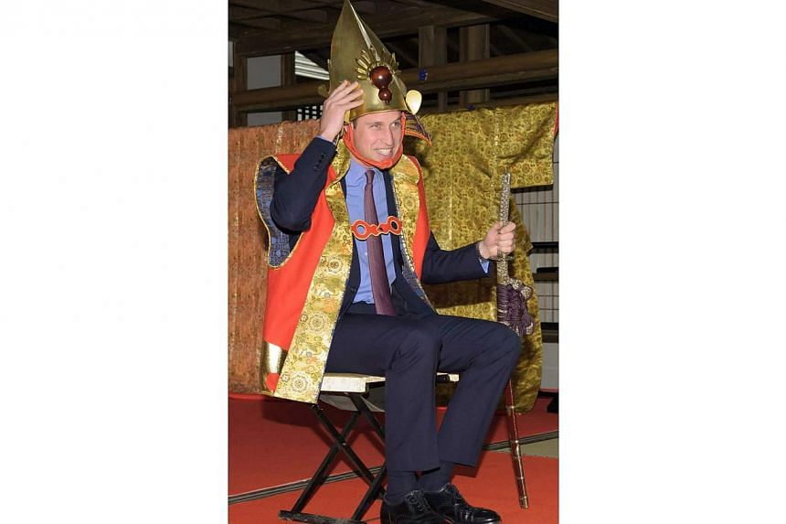 A handout picture provided by NHK shows Britain's Prince William wearing a samurai outfit during his visit to the NHK broadcasting studios in Tokyo on Feb 28, 2015. -- PHOTO: EPA