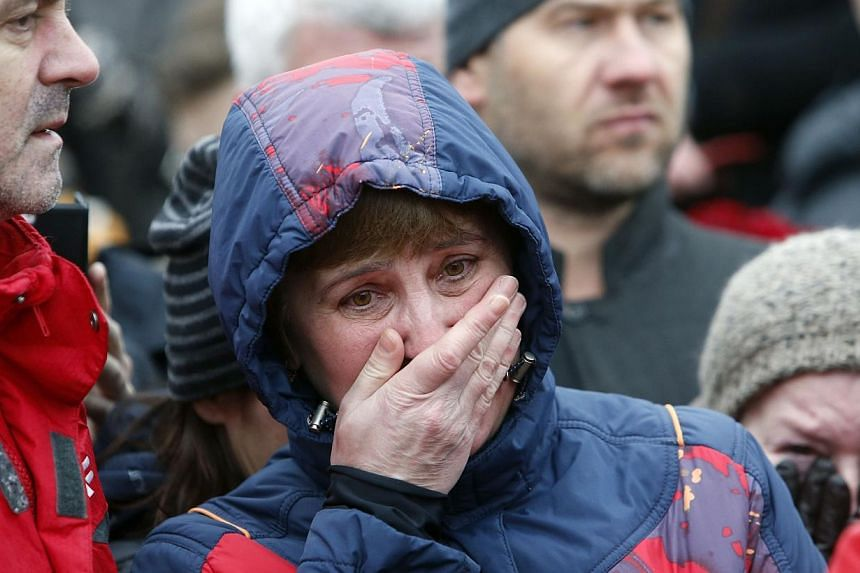 People react at the site, where Boris Nemtsov was recently murdered, in central Moscow, on Feb 28, 2015. -- PHOTO: REUTERS