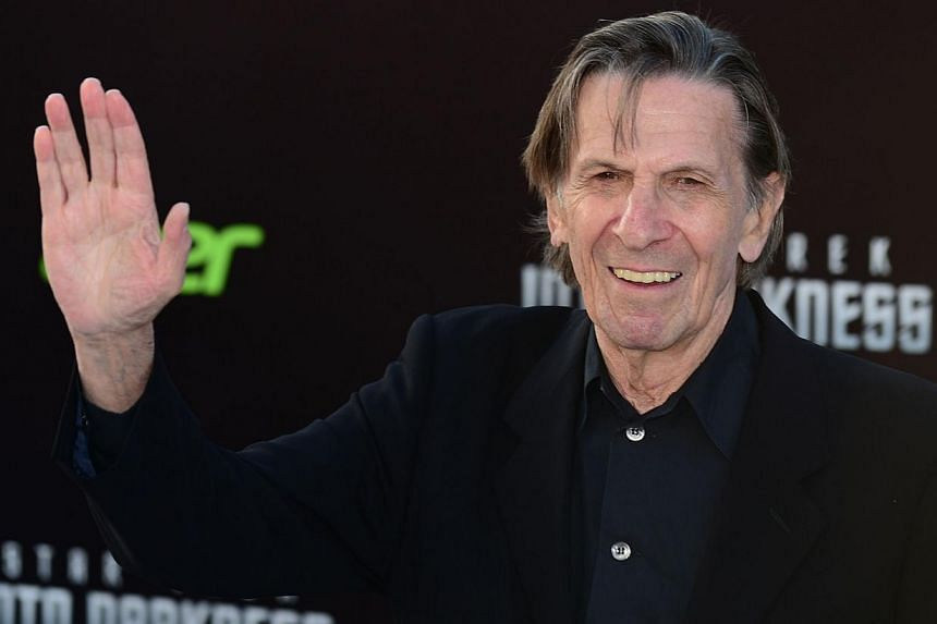Leonard Nimoy, who played the role of Spock in the original Star Trek television series, waves on arrival for the Los Angeles premiere of the movie Star Trek Into Darkness in Hollywood, California, in this May 14, 2013, file photo. Nimoy, who won a w