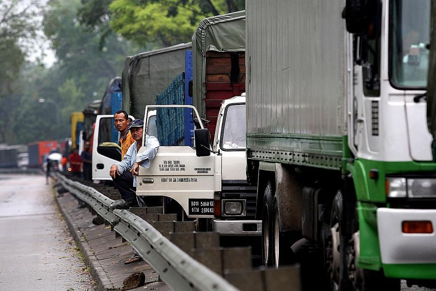 Heavy vehicles will have to be installed with more blind-spot mirrors by October to improve safety. -- PHOTO: ST FILE