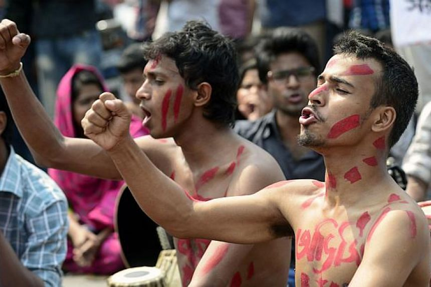 Bangladeshi social activists shout slogans during a protest against the killing of US blogger of Bangladeshi origin, Avijit Roy - founder of the Mukto-Mona (Free-mind) blog site - who was hacked to death by unidentified assailants, in Dhaka on Feb 27