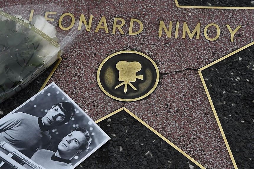 Flowers and a photo are placed on the star of actor Leonard Nimoy on Feb 27, 2015 on the Hollywood Walk of Fame, in Hollywood, California. -- PHOTO: AFP