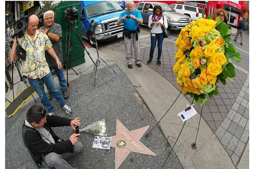 Reporters and members of the public gather at Leonard Nimoy's star on the Hollywood Walk of Fame in Hollywood, California on Feb 27, 2015. -- PHOTO: EPA