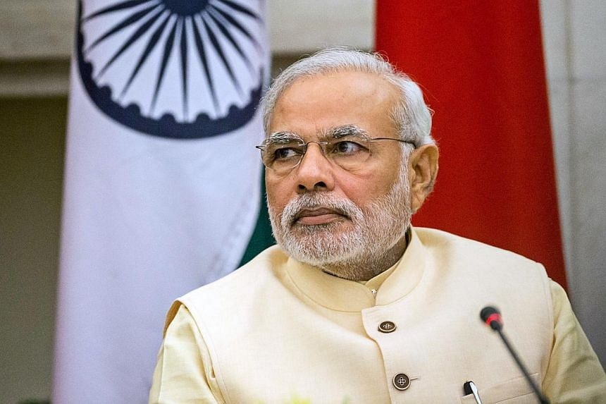 India Prime Minister Narendra Modi's Bharatiya Janata Party and the Peoples Democratic Party are expected to be officially sworn into office in Kashmir's winter capital of Jammu in a tightly secured ceremony. -- PHOTO: BLOOMBERG