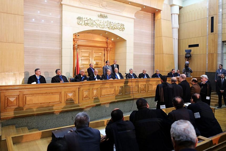 Egyptian judges of the Supreme Constitutional Court are seen during a session to look into election laws, in Cairo on Feb 25, 2015.Egypt's Supreme Constitutional Court ruled on Sunday, March 1, that an article in a law defining voting districts