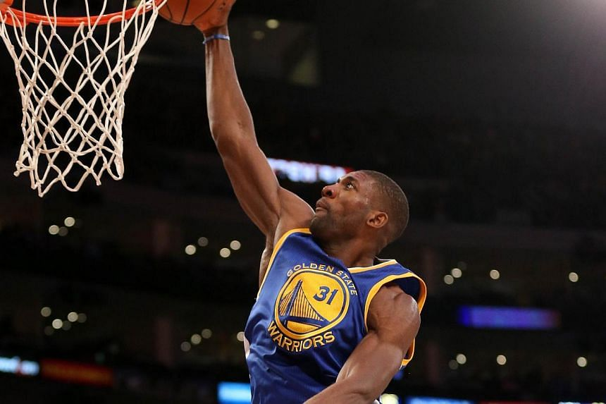 Festus Ezeli of the Golden State Warriors goes up for a shot against the Los Angeles Lakers at Staples Center on Dec 23, 2014 in Los Angeles, California. -- PHOTO: AFP