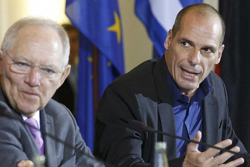 German Finance Minister Wolfgang Schaeuble (left) and Greek Finance Minister Yanis Varoufakis address a news conference following talks at the finance ministry in Berlin on Feb 5, 2015. The German Finance Minister said on Sunday, March 1, that G