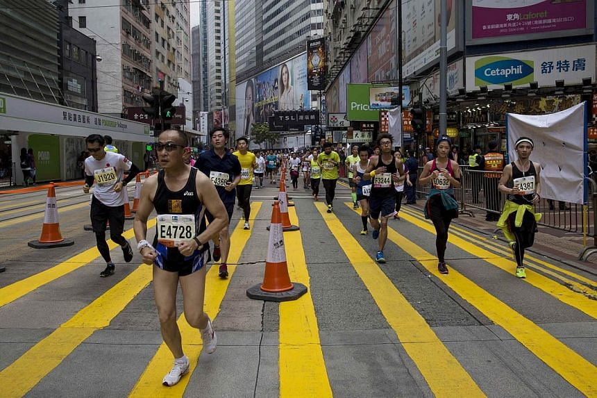 Hundreds of runners competed in Hong Kong's first inner city ultra marathon on Sunday despite a repetitive two-kilometre course which has been criticised as simply too boring. -- PHOTO: REUTERS