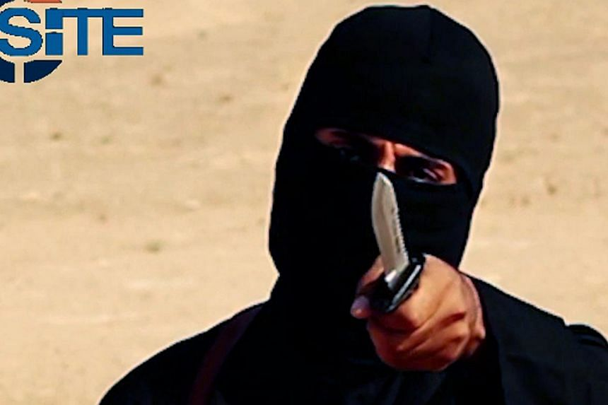 A masked, black-clad militant, who has been identified by the Washington Post newspaper as a Briton named Mohammed Emwazi, brandishes a knife in this still image from a 2014 video obtained from SITE Intel Group on Feb 26, 2015. -- PHOTO: REUTERS