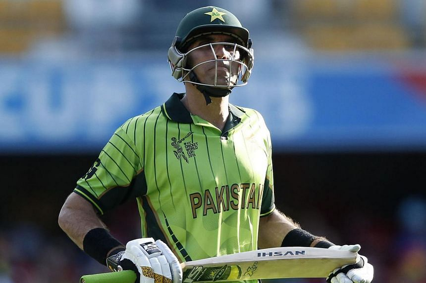 Pakistan's captain Misbah-ul-Haq reacts as he walks off the ground after being dismissed for 73 runs during their Cricket World Cup match against Zimbabwe at the Gabba in Brisbane March 1, 2015. -- PHOTO: REUTERS