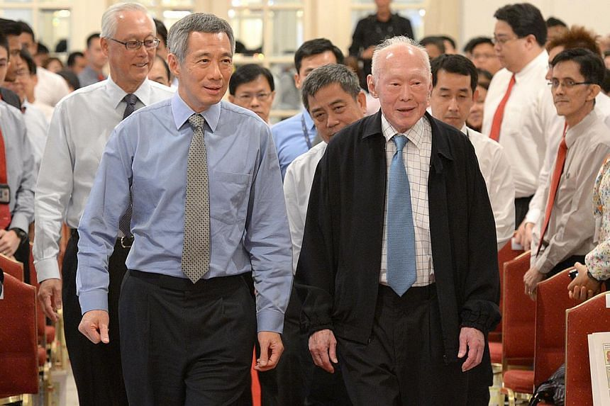 Prime Minister Lee Hsien Loong (left), former prime minister Lee Kuan Yew and Emeritus Senior Minister Goh Chok Tong (behind PM Lee) at the Istana in 2012. A key tenet of governance here has always been to ensure that good people will be in charge, M