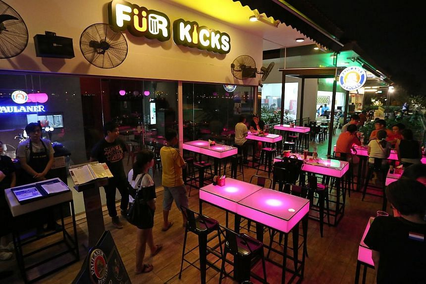 Punggol newcomers also include bistro bar Fur Kicks (left) in The Punggol Settlement. Brunch cafe Whisk & Paddle in Tebing Lane is co-owned by (above from left) Pan siblings Victoria, 29, Junjie, 26, and Shushan, 28. With them is chef Mario Ian Lee (
