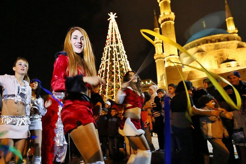Lebanese love to party, as they did during a Christmas tree lighting in Beirut last year. -- PHOTO: REUTERS