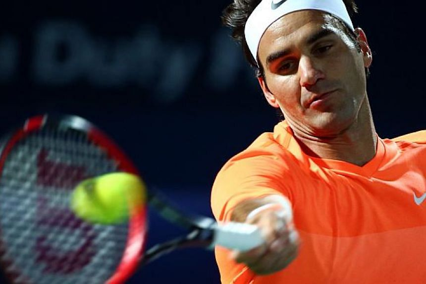 Roger Federer in action (above) at the Dubai Open on Feb 28, 2015. Federer scored the 84th title win of his career, kept his nose in front in his personal rivalry with Novak Djokovic, and equalled his best achievement at any tournament by winning the