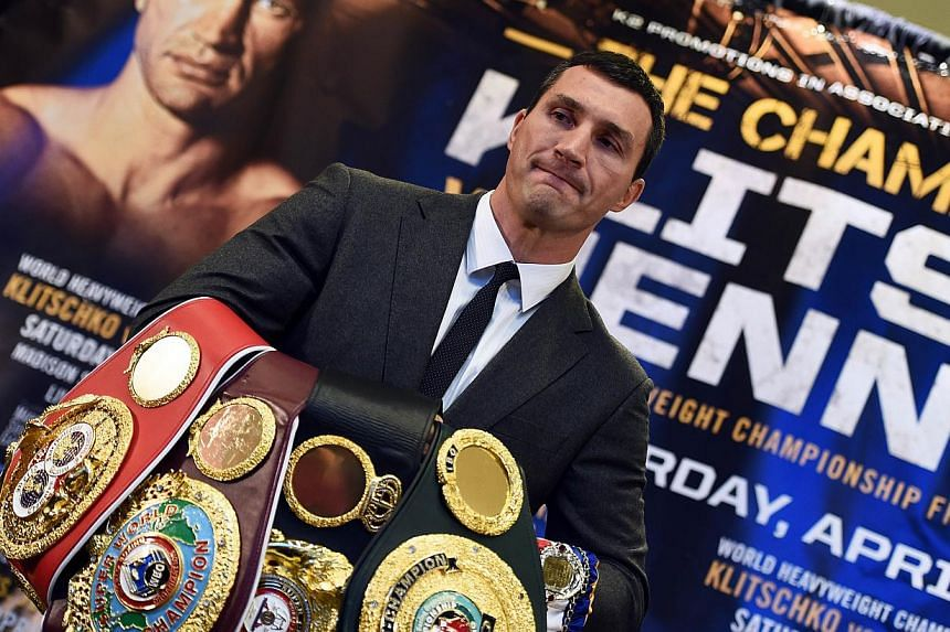 World Heavyweight boxing champion Wladimir Klitschko of Ukraine holds his belts before posing with US challenger Bryant Jennings during a news conference at the Madison Square Garden in New York on Feb 4, 2015. -- PHOTO: AFP