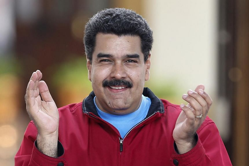 "Venezuelan President Nicolas Maduro (above) announced Saturday he was implementing a mandatory visa system for all American citizens visiting the country, as a way to ""control"" US interference. -- PHOTO: REUTERS"