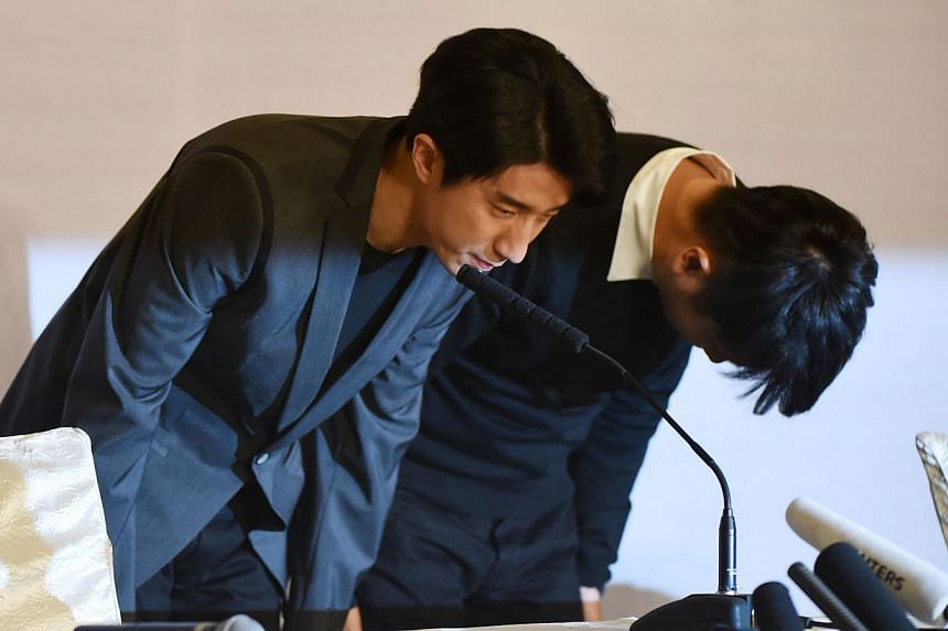 Actor Jaycee Chan (left) and his manager Steven Zhu bow at the beginning of a press conference in Beijing on Feb 14, 2015 following the former's release from jail. Jail has done actor Jaycee Chan a world of good, according to his dad, super