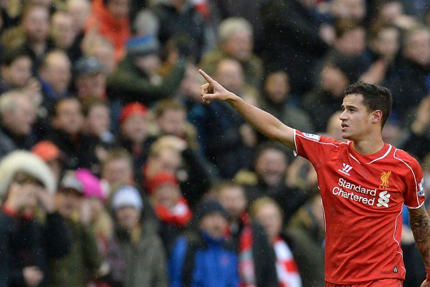 Liverpool's Brazilian midfielder Philippe Coutinho celebrates scoring their second goal during the English Premier League football match against Manchester City at Anfield in Liverpool, north west England, on March 1, 2015. -- PHOTO: AFP