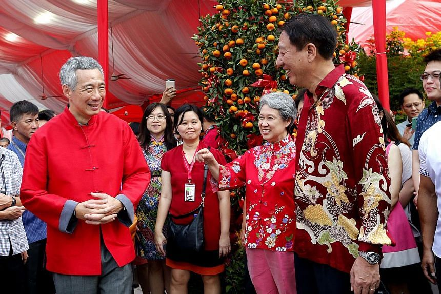 (From left to right) Prime Minister Lee Hsien Loong, his wife Ho Ching and Deputy Prime Minister Teo Chee Hean at the annual Chinese New Year Garden Party held on the Istana Lawn on March 1, 2015. -- ST PHOTO: CHEW SENG KIM
