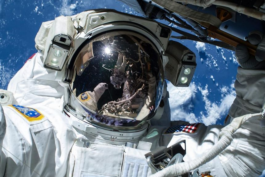 US NASA astronaut Barry Wilmore operating outside the International Space Station on the first of three spacewalks preparing the station for future arrivals by US commercial crew spacecraft, in a handout photo from NASA. US spacewalker Terry Virts is