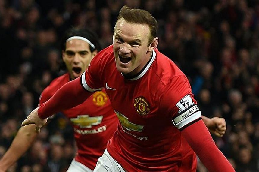 Manchester United's English striker Wayne Rooney celebrates scoring a penalty against Sunderland at Old Trafford on Feb 28, 2015. -- PHOTO: AFP
