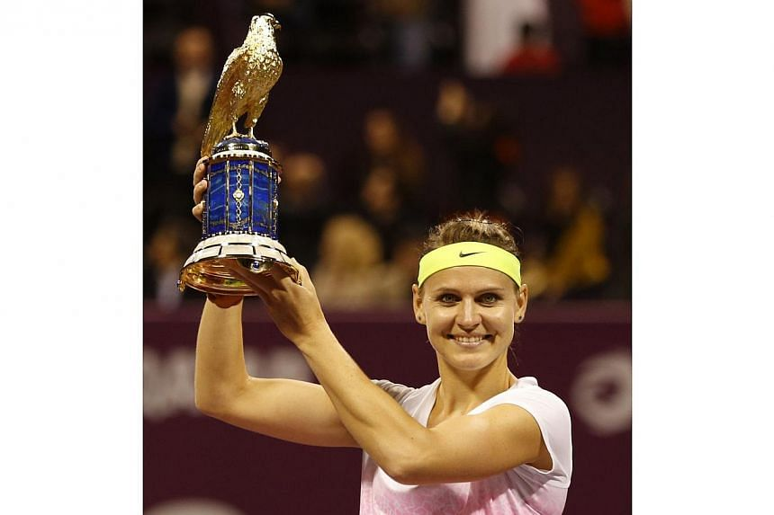 Lucie Safarova of the Czech Republic celebrates her Qatar Open win on Feb 28, 2015 in Doha. -- PHOTO: AFP