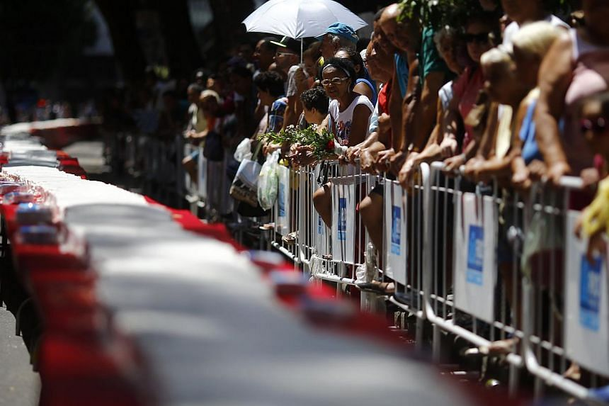 The confectionary was the centrepiece of the city's birthday celebrations, and was served up on a long table reaching down Carioca Street in the heart of the city.-- PHOTO: REUTERS