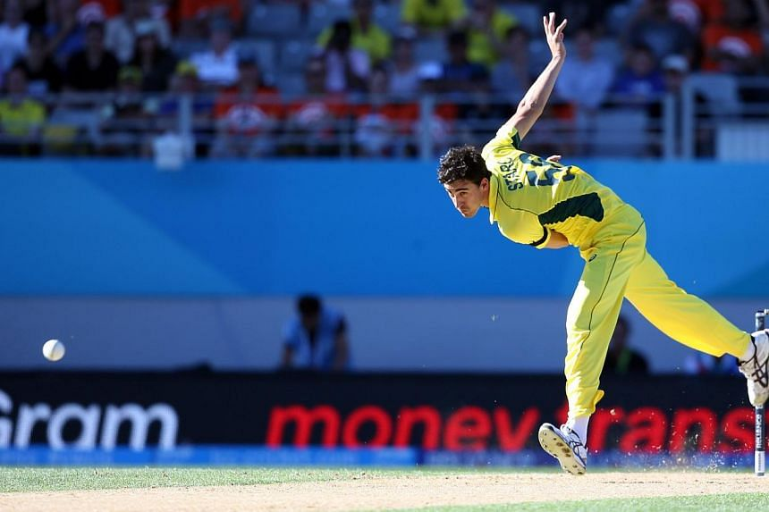 Australia's Pat Cummins bowls during the Pool A 2015 Cricket World Cup match between New Zealand and Australia at Eden Park in Auckland on Feb 28, 2015. -- PHOTO: AFP
