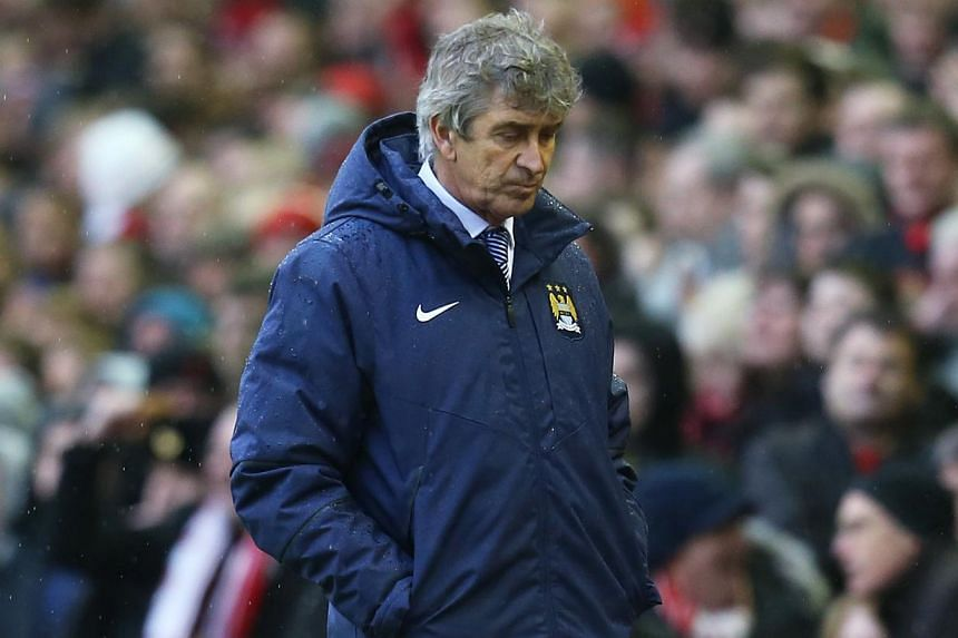 Manchester City manager Manuel Pellegrini looking dejected during his team's English Premier League match against Liverpool on Sunday, March 1, 2015. Manchester City lost 2-1. -- PHOTO: REUTERS