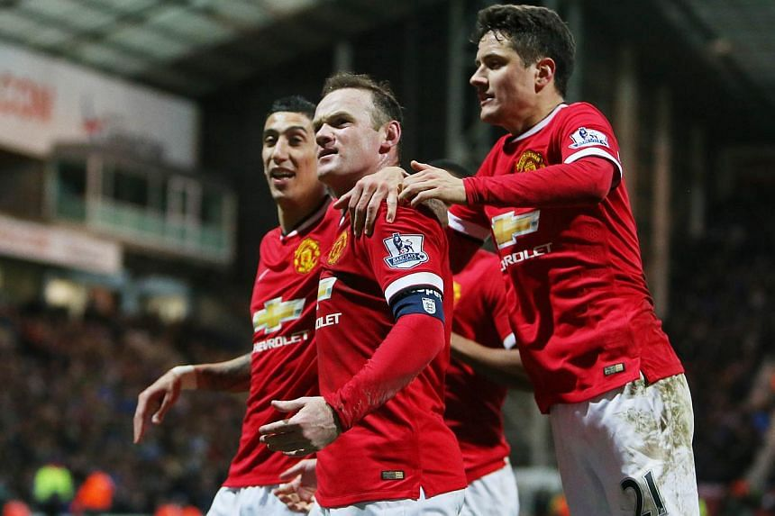 Manchester United's Wayne Rooney (centre) celebrates scoring their third goal with Angel Di Maria (left) and Ander Herrera during their FA Cup match against Preston North End on Feb 16, 2015. Di Maria is a great player and will rediscover his be