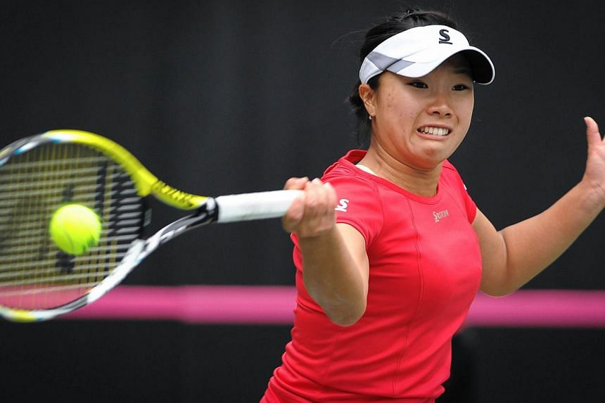 Kurumi Nara of Japan returns to Yaroslava Shvedova of Kazakhstan at the International Tennis Federation Fed Cup Asia/Oceania group match in Guangdong Olympic Tennis Centre in Guangzhou, south China's Guangdong province on Feb 7, 2015. -- PHOTO: AFP