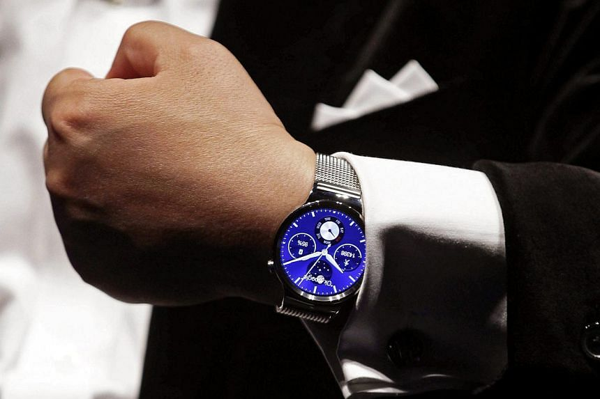 Mr Richard Yu, CEO of Huawei Technologies Consumer Business Group, presents the Huawei Watch during the Mobile World Congress mobile communications convention in Barcelona, Spain, on Mar 1, 2015.China's Huawei Technologies unveiled its first sm