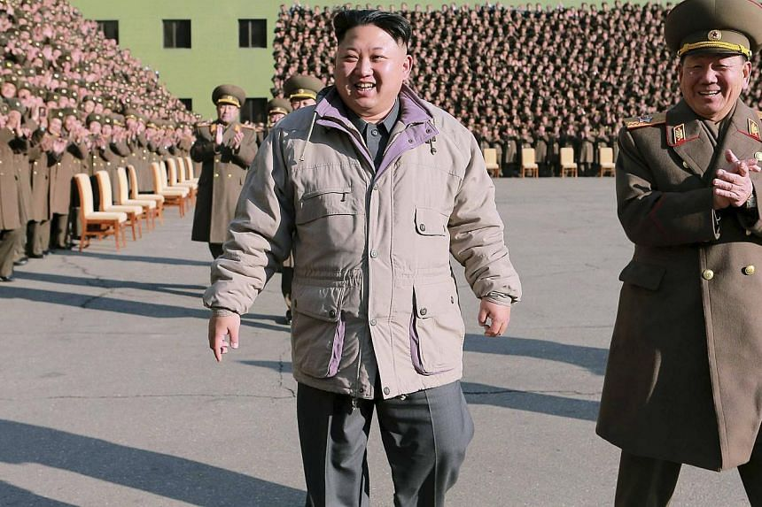 North Korean leader Kim Jong Un at a photo session with participants in the second meeting of KPA logistic personnel in this photo released by North Korea's Korean Central News Agency (KCNA) in Pyongyang on Dec 25, 2014. -- PHOTO: REUTERS