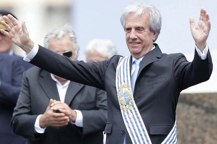 Uruguay's new president Tabare Vazquez gesturing after receiving the presidential sash from his predecessor, Jose Mujica (left, partially obscured) in Montevideo on March 1, 2015. -- PHOTO: REUTERS