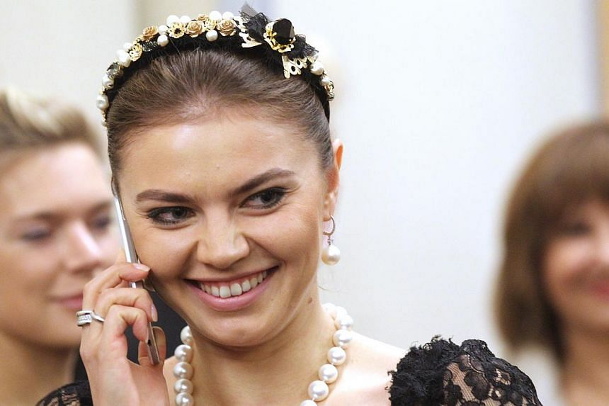 Russian retired rhytmic gymnast and politican Alina Kabaeva attends a reception at the Bocharov Ruchey state residence in Sochi, Russia on Feb 8, 2014 . -- PHOTO: GETTY IMAGES