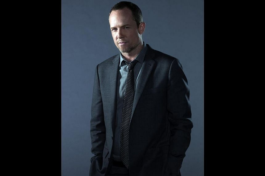 Dean Winters (above) plays a hard-boiled cop in new TV comedy-drama Battle Creek with Josh Duhamel as his partner. -- PHOTO: FOX