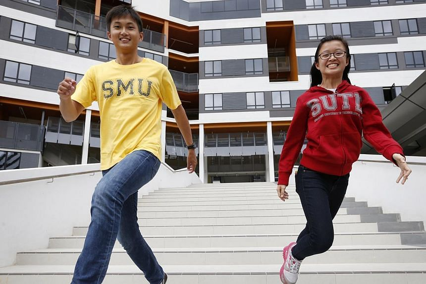 Among the pioneer batch are students Clement Chua (left), 22, and Yeo Pei Shan, 20. At the end of the course, they will graduate with a bachelor of business management from SMU and a bachelor of engineering from SUTD.