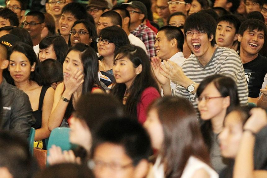 Junior College students cheering during the release of GCE A-level results. About 14,000 students took the A-level examinations last year and will be collecting their results on March 2, 2015. -- PHOTO: ST FILE
