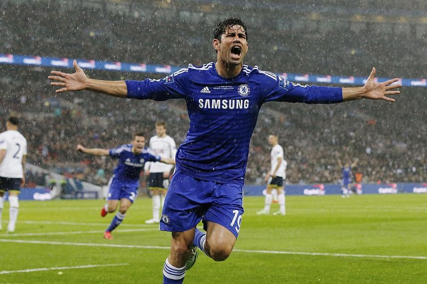 Chelsea forward Diego Costa celebrating after having a hand in his side's second goal against Tottenham Hotspur in the League Cup final at Wembley on March 1, 2015. -- PHOTO: REUTERS