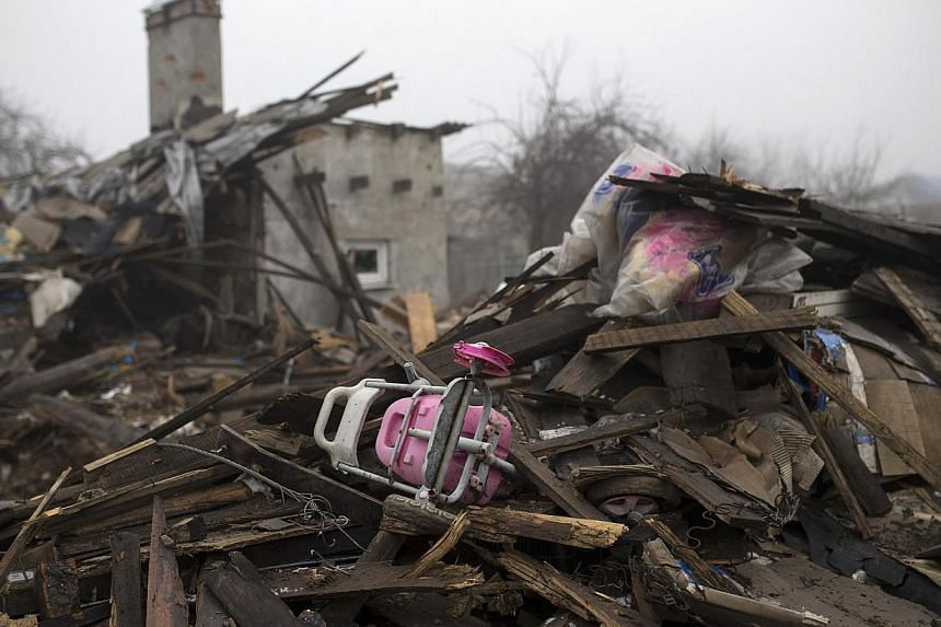 A child's toy is seen in the ruins of a house in a neighborhood near the Donetsk airport on March 1, 2015. United Nations' High Commissioner for Human Rights Zeid Ra'ad Al Hussein on March 2said more than 6,000 have been killed in the violence